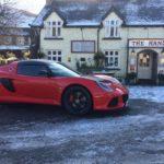 Lotus Exige Sport 350 outside snowy The Hand Hotel at Llanarmon
